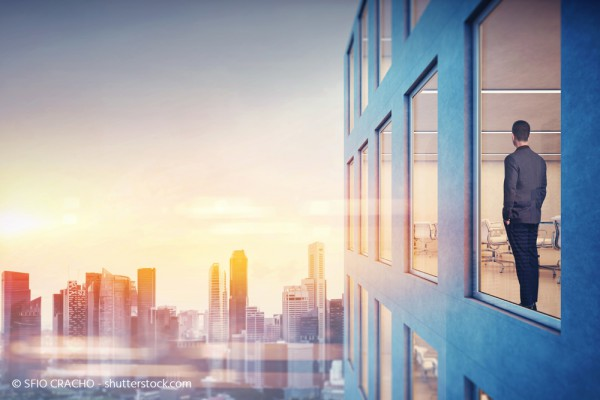 social_media_stock-photo-skyline-businessman-is-looking-at-city-260730530